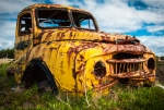 Abandoned yellow pickup truck